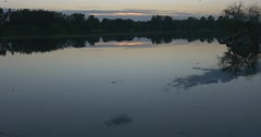 Hotspot of Sunset on The Water, Wide Shot,Pond, River, Trees` Silhouettes Stock Footage