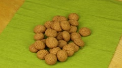 Amaretti biscuits rotate on a green background Stock Footage