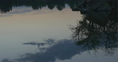 Stony Island with Tree,Trees Silhouettes`and Sky`s Reflection, Twilight, Blue Stock Footage