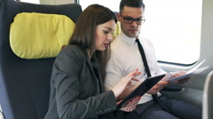 Businesspeople traveling to work by train, steadycam shot Stock Footage