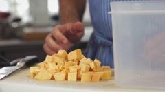 Food, Putting chopped raw potatoes in plastic tupperware box - stock footage