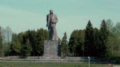 Statue of Lenin near city Dubna on the shore of Moscow canal Stock Footage