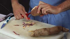 Food, Peeling potatoes in marble countertop in slow motion - stock footage