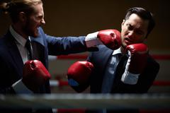 Fight with business rival - stock photo