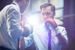Businessman attacking rival Stock Photos
