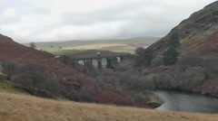 Craig Goch Dam overflowing in autumn, Elan Valley, Wales Stock Footage