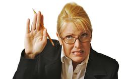 Female Student Reluctant to Raise Her Hand - stock photo