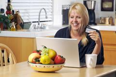 Woman Using Laptop for E-commerce Stock Photos