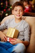 Boy with xmas presents Stock Photos