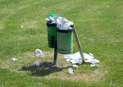 Trash bin full in an outdoor park Stock Photos