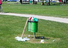Trash bin full in an outdoor park - stock photo