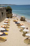 The beach in the Algarve town of Armacao de Pera southern Portugal - stock photo