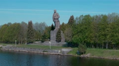Giant Lenin monument on the shore on Moscow canal near Dubna-city Stock Footage