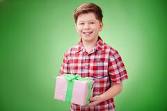 Boy holding present - stock photo