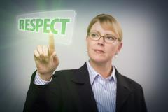 Attractive Blonde Woman Pushing Respect Button on an Interactive Touch Screen - stock photo