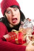 Excited Woman Balancing Holiday Gifts - stock photo
