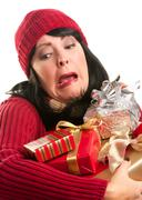 Attractive Woman Fumbling with Her Holiday Gifts Stock Photos