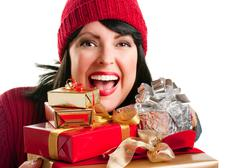 Happy, Attractive Woman Holds Holiday Gifts Isolated on a White Background. - stock photo