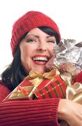 Attractive Woman Holds Holiday Gifts Isolated on a White Background. - stock photo