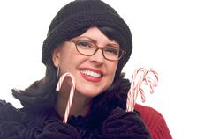 Attractive Woman Holds Candy Canes Isolated on a White Background. - stock photo