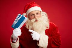 Santa with airline tickets Stock Photos