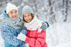 Couple in snowfall - stock photo