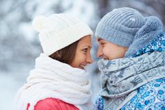 Sweethearts in winterwear - stock photo