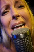 Woman Sings with Passion - stock photo