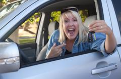 Attractive Happy Woman In New Car with Keys. Stock Photos
