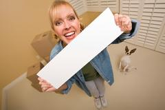 Woman and Doggy with Blank Sign Near Moving Boxes Stock Photos