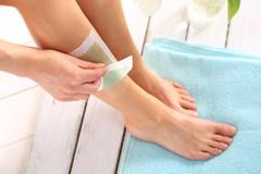 Leg Hair.Removal wax. Stock Photos