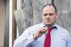 man at construction site smoking a cigar - stock photo