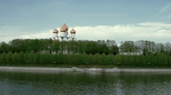 Traditional Russian Church on the river shore in spring in a daytime - stock footage