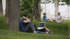 Summer Park Young Peoples On The Grass Look Laptop - stock footage