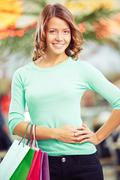 Girl with shopping-bags Stock Photos