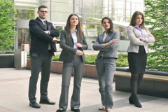 Businesspeople standing and doing serious look to the camera Stock Footage