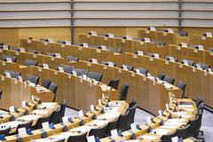 Row of seats at the Plenary Chamber at the European Parliament Stock Photos