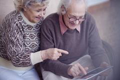 Pointing at touchscreen Stock Photos