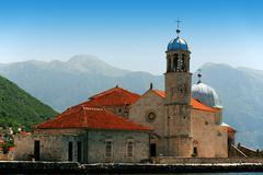 Our Lady of the Rocks, one of the two islets off the coast of Perast in Bay o Stock Photos