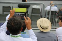 Man Taking Photo on Tennis Tournament using Tablet Stock Photos