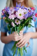 Fresh irises and daisies - stock photo