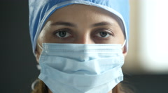 Surgeon's face with surgical mask and cap Stock Footage