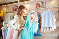Shopaholic with dress Stock Photos