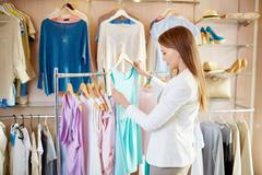 Girl in boutique Stock Photos