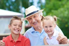 Grandpa with children Stock Photos