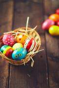 All eggs in a basket Stock Photos