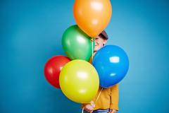 Stock Photo of Boy with balloons