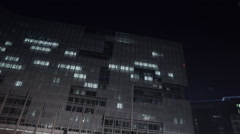The European Commission at night with EU flags Stock Footage