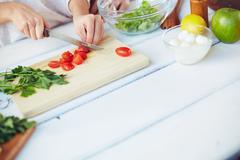Cooking Greek salad - stock photo