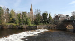 Bridge across river Ericht and church in Rattray Scotland Stock Footage